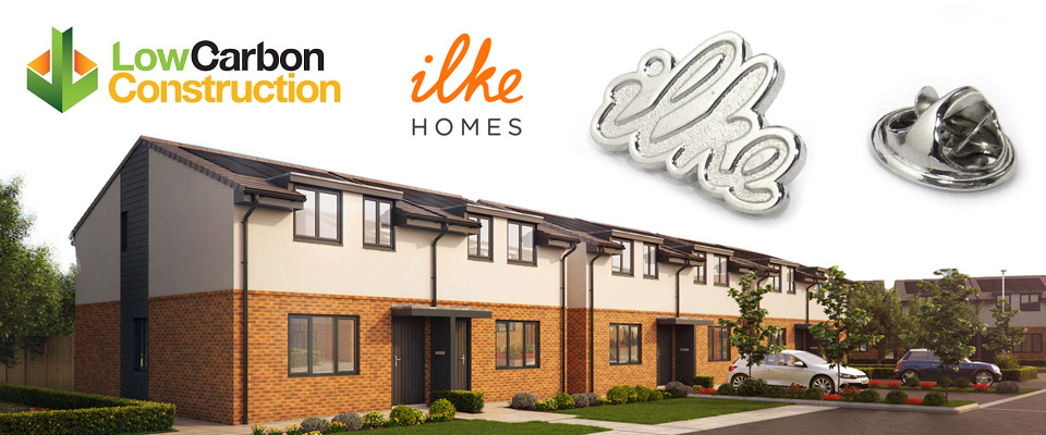 silver plated Ilke Homes lapel pin badges