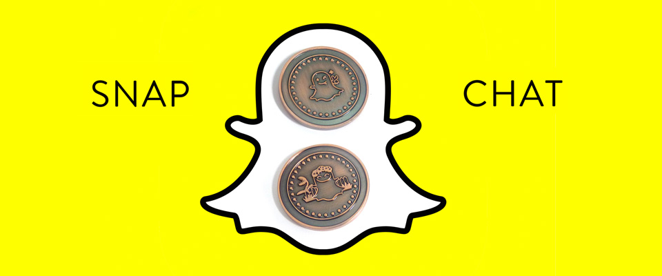 Pesonalised reversible challenge coins made for a Snap Chat promotion